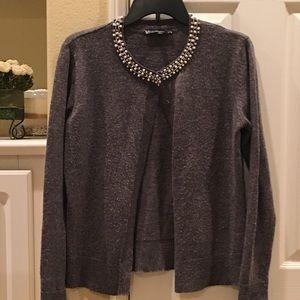 Grey cardigan with pearl crystal bib necklace